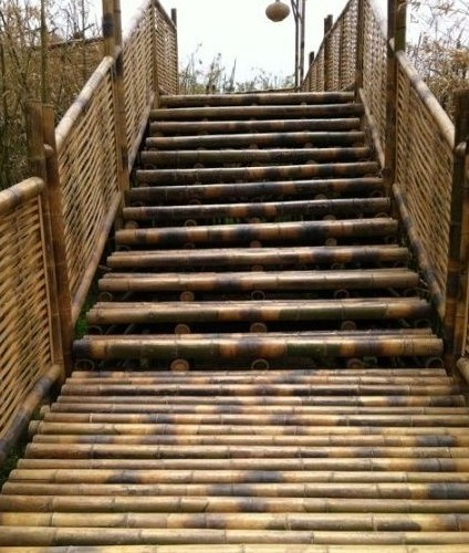 Bamboo Bridge With Bamboo Pole Stairs And Weaving Bamboo Rails