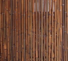 colored bamboo fence stained